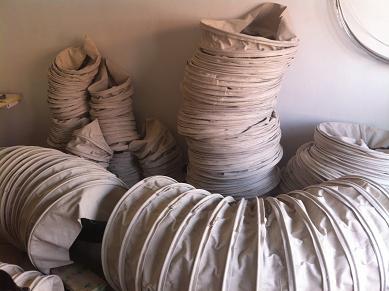 白色散装机水泥输送布袋产品图